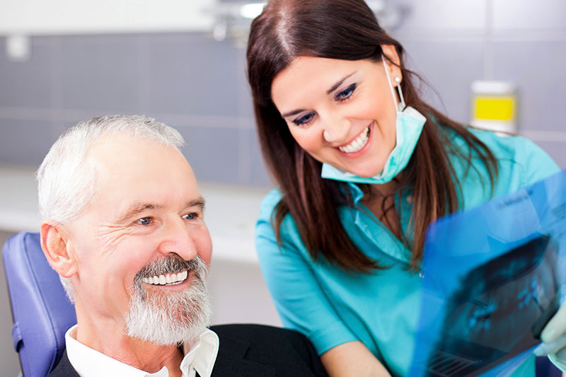 Dental Implants vs Dentures in South Lake Tahoe Dentist